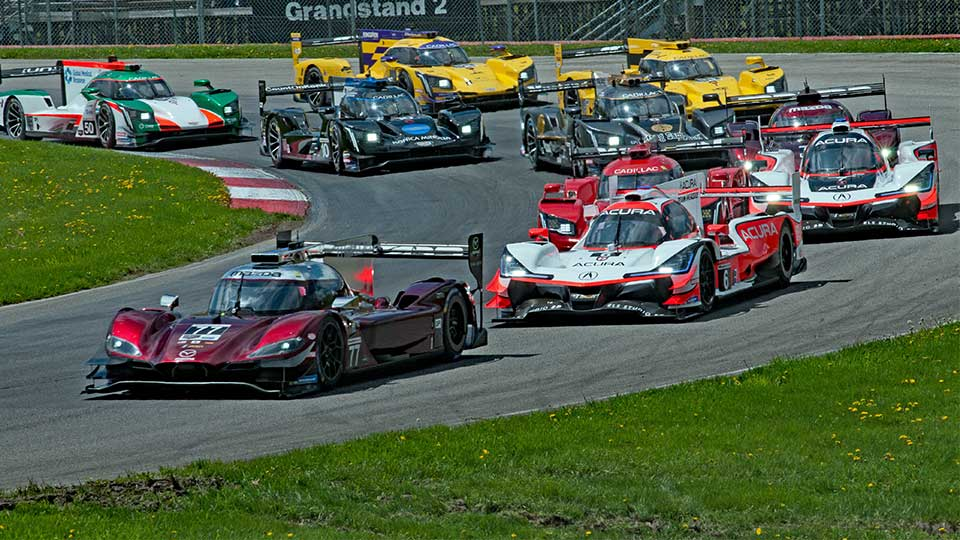 Prototype cars make their way through turn 4 of the Mid-Ohio Sports Car Course