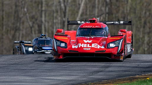 Prototype cars race through the Mid-Ohio Sports Car Course