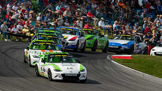 MX-5 cars race through the Mid-Ohio Sports Car Course